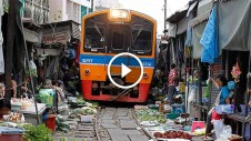 unbelievable train runs trough vegetable market in thailand