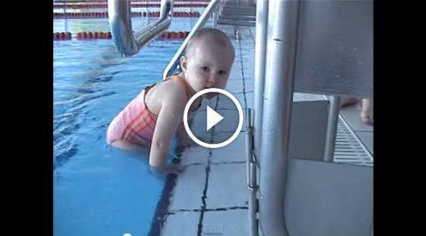 Cute little baby girl swimming